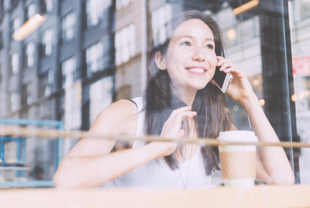 Student on coffee break inside a shop