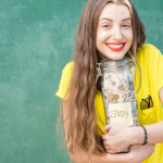 Female student holding a jar of money