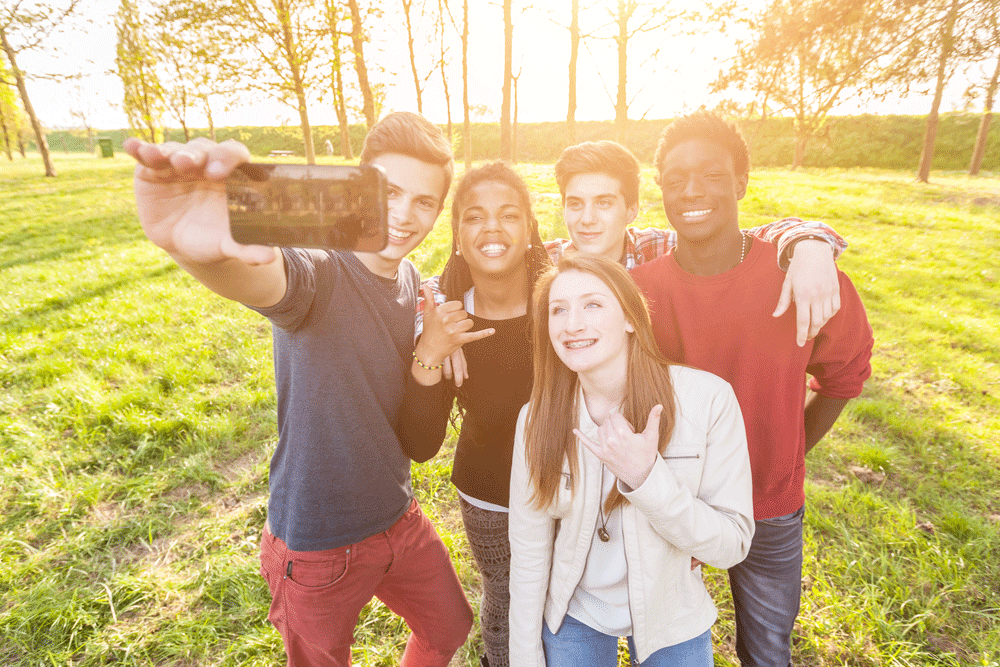 A group of friends taking a selfie in the park